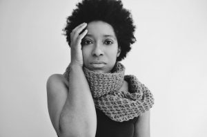 Black and white image of black woman in scarf black tank top natural self-portrait